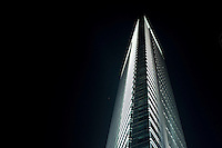 Evening Low Angle View Of A Tall Commercial Building With Lights in Guangzhou, China.  © LAN