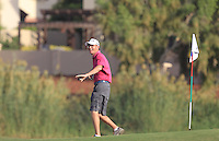 Dermot Byrne, caddy for Shane Lowry (IRL) on the 17th green during the preview for the DP World Tour Championship at the Earth course,  Jumeirah Golf Estates in Dubai, UAE,  18/11/2015.<br /> Picture: Golffile | Thos Caffrey<br /> <br /> All photo usage must carry mandatory copyright credit (© Golffile | Thos Caffrey)