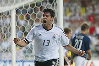 Michael Ballack celebrates scoring the only goal of the game. The USA lost to Germany 1-0 in the Quarterfinals of the FIFA World Cup 2002 in South Korea on June 21, 2002.