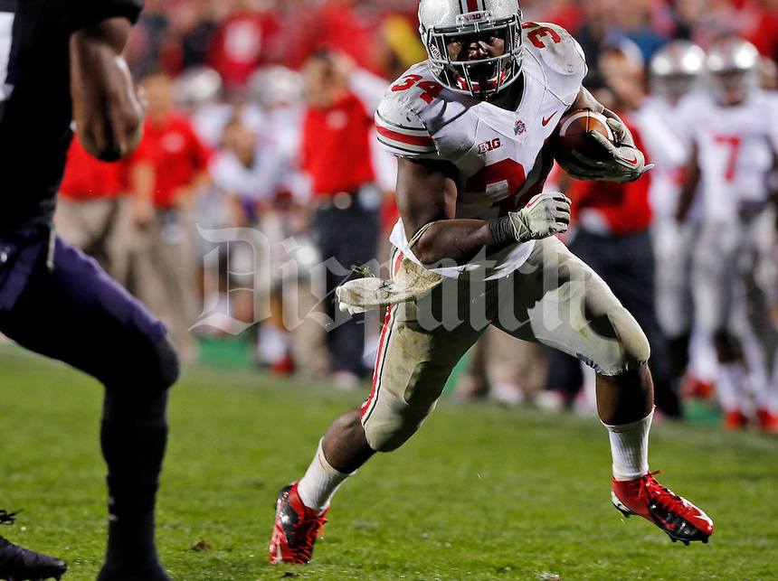 Ohio State Buckeyes running back Carlos Hyde (34)  makes a run for a touchdown but is pushed out of bounds in the fourth quarter of their game at Ryan Field in Evanston, IL on October 5, 2013. Columbus Dispatch photo by Brooke LaValley)