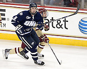 Eric Knodel (UNH - 5), Johnny Gaudreau (BC - 13) - The Boston College Eagles defeated the visiting University of New Hampshire Wildcats 4-3 on Friday, January 27, 2012, in the first game of a back-to-back home and home at Kelley Rink/Conte Forum in Chestnut Hill, Massachusetts.