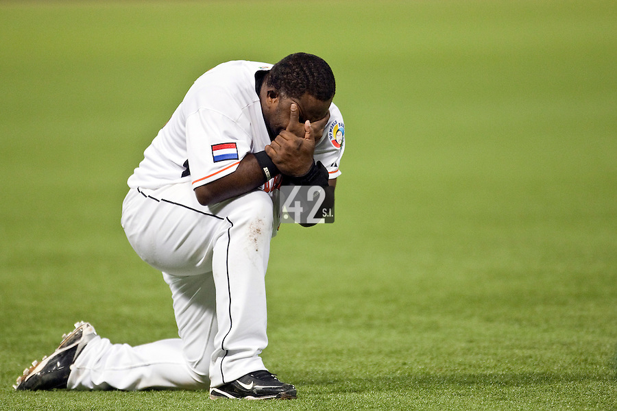 10 March 2009: #35 Randall Simon cries after Netherlands beat Dominican Republic during the 2009 World Baseball Classic Pool D game 5 at Hiram Bithorn Stadium in San Juan, Puerto Rico. The Netherlands pulled off second upset to advance to the secound round. The Netherlands come from behind in the bottom of the 11th inning and beat the Dominican Republic, 2-1.