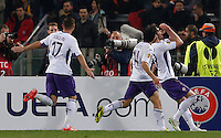 Calcio, Europa League: Ritorno degli ottavi di finale Roma vs Fiorentina. Roma, stadio Olimpico, 19 marzo 2015.<br /> Fiorentina's Jose' Basanta, right, celebrates with teammates Matias Fernandez, center, and Joaquin Sanchez Rodriguez, after scoring during the Europa League round of 16 second leg football match between Roma and Fiorentina at Rome's Olympic stadium, 19 March 2015.<br /> UPDATE IMAGES PRESS/Riccardo De Luca