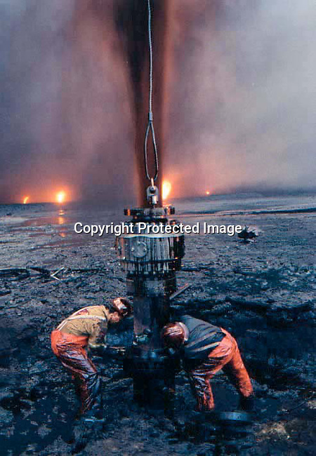 Unidentified firefighters from Canada putting out an oilwell  at Burhan oilfields in Kuwait on August 12, 1991 in the aftermath of the Gulf War. President Saddam Hussein of Irak ordered the wells to be destroyed when his troops withdrew from Kuwait. .(Photo Per-Anders Pettersson)