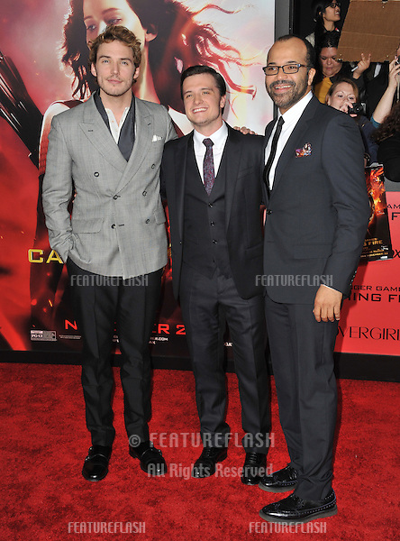 Sam Claflin (left), Josh Hutcherson &amp; Jeffrey Wright at the US premiere of their movie &quot;The Hunger Games: Catching Fire&quot; at the Nokia Theatre LA Live.<br /> November 18, 2013  Los Angeles, CA<br /> Picture: Paul Smith / Featureflash