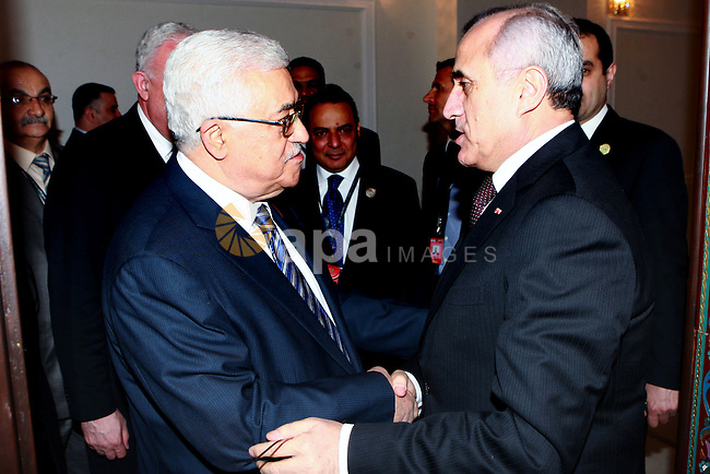 Palestinian President Mahmoud Abbas meets with Lebanese President Michel Suleiman in Baghdad, Iraq, Thursday, March, 29, 2012. The annual Arab summit meeting opened in the Iraqi capital Baghdad on Thursday with only 10 of the leaders of the 22-member Arab League in attendance and amid a growing rift between Arab countries over how far they should go to end the one-year conflict in Syria. Photo by Thaer Ganaim
