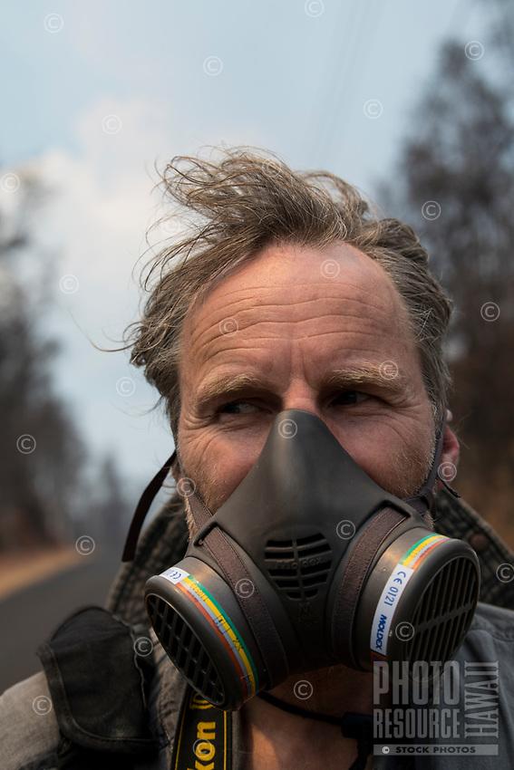 May 2018: A man wears a half-face gas mask near the Kilauea Volcano eruption in Leilani Estates, Puna, Big Island of Hawai'i.