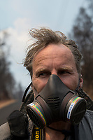 May 2018: A man wears a half-face gas mask near the Kilauea Volcano eruption in Leilani Estates, Puna, Big Island of Hawai'i.