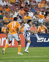 Pachuca FC forward Bruno Marioni (9) controls the ball as Houston Dynamo midfielder Ricardo Clark (13) approaches.  Houston Dynamo defeated Pachuca FC 2-0 in the semifinals of the Superliga 2008 tournament at Robertson Stadium in Houston, TX on July 29, 2008.
