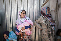 June 12, 2015 - Bekaa Valley, Lebanon: Syrian refugee women queue as they await for humanitarian aid to be distributed in a temporary settlement in Zahlah city in east of Lebanon. (Photo/Narciso Contreras)