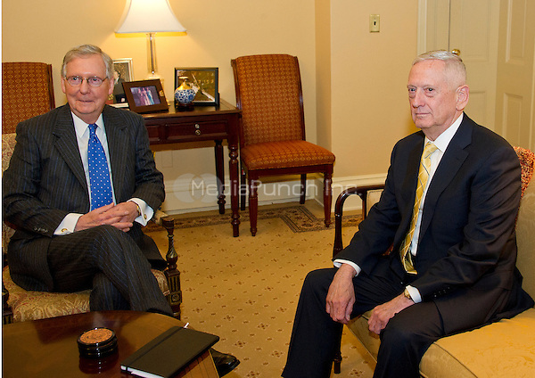 "United States Senate Majority Leader Mitch McConnell (Republican of Kentucky), left, meets retired US Marine Corps General James N. ""Mad Dog"" Mattis, US President-elect Donald J. Trump's selection to be US Secretary of Defense, right, in his office in the US Capitol in Washington, DC on Wednesday, December 7, 2016.<br /> Credit: Ron Sachs / CNP /MediaPunch"