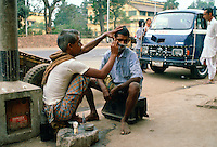 Street barber at work, Delhi, India