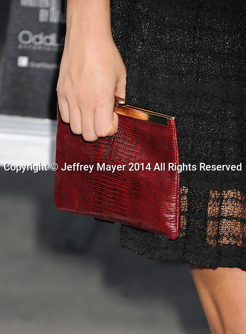 WESTWOOD, CA- APRIL 07: Actress Briana Evigan (handbag detail) at the Los Angeles premiere of 'Draft Day' at the Regency Village Theatre on April 7, 2014 in Westwood, California.