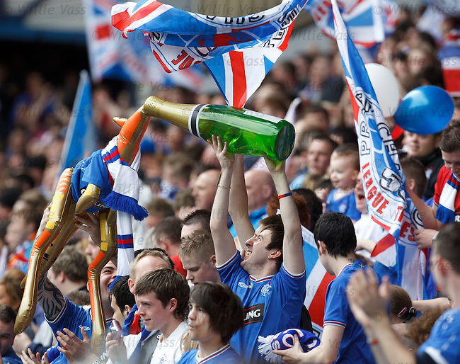 Rangers fans in the Bromloan celebrate a goal by feeding a plastic kangaroo some champagne. Yeah, whatever...