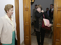 President of the Swiss Confederation Micheline Calmy-Rey (R) smiles as she is welcomed by Catherine Krieg Plojack (L) ambassador of Switzerland in Portugal prior to a meeting at Ambassad , in Lisbon 12 May 2007.