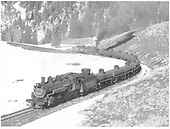 D&amp;RGW #495 leading a tank car train moving up mountain toward Cumbres - near Coxo crossing.<br /> D&amp;RGW  Coxo, CO  Taken by Richardson, Robert W. - 2/26/1954