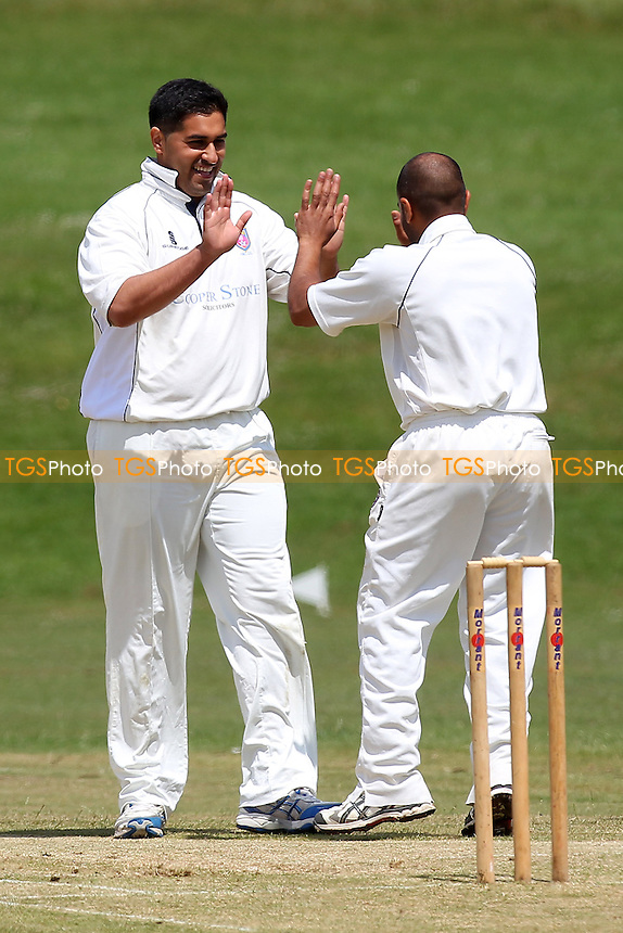 Mo Ismail of Hainault celebrates the wicket of Paul Hurworth - Ardleigh Green CC (batting) vs Hainault & Clayhall CC - Essex Cricket League - 28/06/14 - MANDATORY CREDIT: Gavin Ellis/TGSPHOTO - Self billing applies where appropriate - 0845 094 6026 - contact@tgsphoto.co.uk - NO UNPAID USE