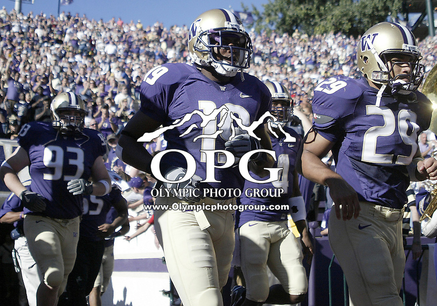 SEPT 23, 2006:  Washington Huskies wide receivers (left) #19 Quinton Daniels and (right) #29 Cody Ellis run out from the Husky tunnel and onto the field against UCLA...The Washington Huskies won 29-19 over the UCLA Bruins at Husky stadium in Seattle, WA.