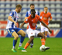 Blackpool's Viv Solomon-Otabor battles with Wigan Athletic's Ryan Colclough<br /> <br /> Photographer Dave Howarth/CameraSport<br /> <br /> The Carabao Cup - Wigan Athletic v Blackpool - Tuesday 8th August 2017 - DW Stadium - Wigan<br />  <br /> World Copyright &copy; 2017 CameraSport. All rights reserved. 43 Linden Ave. Countesthorpe. Leicester. England. LE8 5PG - Tel: +44 (0) 116 277 4147 - admin@camerasport.com - www.camerasport.com