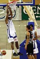 Saints import Damon Thornton hangs off the basket after slamdunking during the NBL match between the Wellington Saints and Christchurch Cougars at Te Rauparaha Stadium, Porirua, Wellington, New Zealand on Saturday 4 April 2009. Photo: Dave Lintott / lintottphoto.co.nz