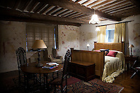 The master bedroom boasts a series of wall paintings which date back to the early 16th century