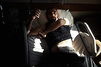 Wounded FSA soldier showing the bullet that was taken out of him in a hospital bed in Antakya