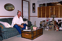 FREMONT, CA - Al Mangin sits in the family room with a Budweiser beer in 1987 in Fremont, California. (Photo by Brad Mangin)