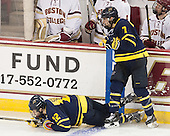 Vinny Scotti (Merrimack - 12), Jonathan Lashyn (Merrimack - 7) - The Boston College Eagles defeated the visiting Merrimack College Warriors 2-1 on Wednesday, January 21, 2015, at Kelley Rink in Conte Forum in Chestnut Hill, Massachusetts.
