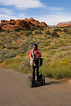 Woman on a Segway at Snow Canyon State Park, Utah, UT, scenic, landscape, Segways, Segway rider, model released, transportation, rock formations, landforms, arid, Southwest America, American Southwest, US, United States, Image ut412-18829, Photo copyright: Lee Foster, www.fostertravel.com, lee@fostertravel.com, 510-549-2202