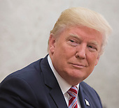 United States President Donald J. Trump speaks to the media during a meeting with Amir Sabah al-Ahmed al-Jaber al-Sabah of Kuwait(unseen) in the Oval Office of The White House in Washington, DC, September 7, 2017. <br /> Credit: Chris Kleponis / Pool via CNP