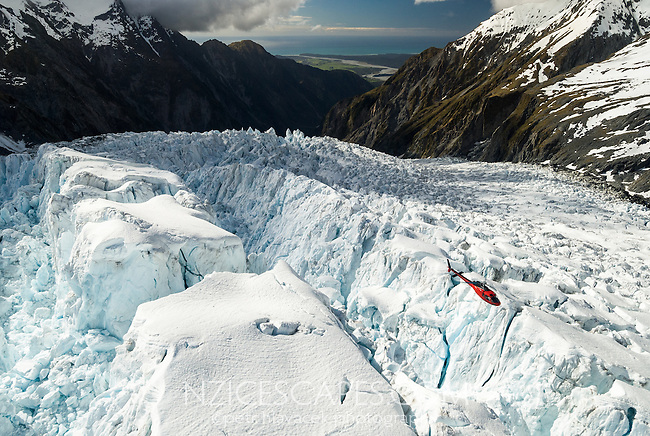 Helicopter flying through crevasses of Franz Josef Glacier icefall, Westland Tai Poutini National Park, UNESCO World Heritage Area, South Westland, West Coast, New Zealand, NZ