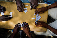 Haitian men play dominoes on the street of Port-au-Prince, Haiti, 10 July 2008.