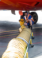 5/5/2008 11:09:31 AM -- Seattle, WA, U.S.A.Southwest Airlines ground crew member Michael Delight, 37, disconnects a precondition air unit from a Southwest Airlines jet at Seattle International Airport Monday May 5, 2008 in Seattle. The precondition air unit allows the jet to shut off its auxiliary power unit while on the ground at the gate saving on jet fuel and reducing emissions.  .