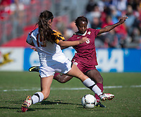 Erika Nelson (15) of Maryland moves in to block the shot of Jessica Price (6) of Florida State during the game at Ludwing Field in College Park, MD.  Florida State defeated Maryland, 1-0.