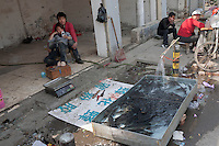 A couple sells fish at Dawangjing Village which is being demolished on April 9, 2009 on the outskirts of Beijing, China. The local authorities are evicting residents, who are mainly migrant workers, to redevelop the area. The redevelopment of Beijing continues in high speed.