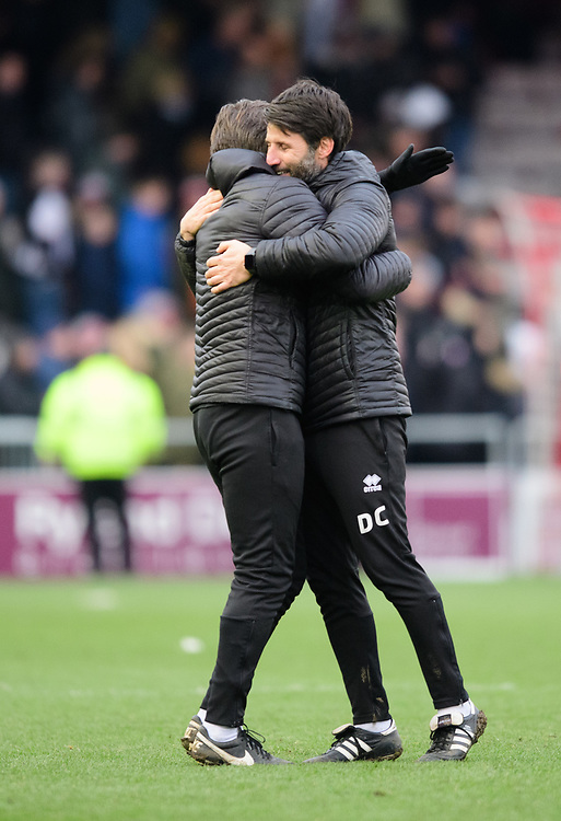 Lincoln City's assistant manager Nicky Cowley, left, and Lincoln City manager Danny Cowley celebrate at the end of the game<br /> <br /> Photographer Chris Vaughan/CameraSport<br /> <br /> The EFL Sky Bet League Two - Lincoln City v Grimsby Town - Saturday 19 January 2019 - Sincil Bank - Lincoln<br /> <br /> World Copyright &copy; 2019 CameraSport. All rights reserved. 43 Linden Ave. Countesthorpe. Leicester. England. LE8 5PG - Tel: +44 (0) 116 277 4147 - admin@camerasport.com - www.camerasport.com