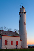 Alcona County, Michigan<br /> Sturgeon Point Light (1869) with the dawn colored sky over Lake Huron
