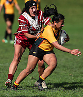 Louisa Gago of Manurewa is caught by Leanne Gardiner of Papakura. Premier Women's Rugby League, Papakura Sisters v Manurewa Wahine, Prince Edward Park, Auckland, Sunday 13th August 2017. Photo: Simon Watts / www.phototek.nz