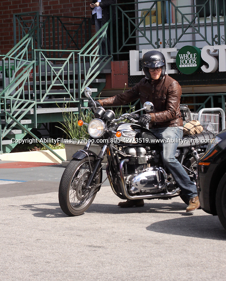 Feb 29th 2012   Exclusive...Bryan Greenberg shopping at Whole Foods market riding off on his Triumph motorcycle in west Hollywood California ...AbilityFilms@yahoo.com.805-427-3519.www.AbilityFilms.com..