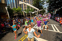 On-location event photography at the 2014 Charlotte Pride Festival and Parade in Uptown Charlotte, North Carolina. Charlotte Pride presents the annual lesbian, gay, bisexual, transgender, questioning and queer (LGBTQ) Pride festival and other events in the Queen City. The annual festival attracted over 80,000 people to the two day event in Downtown Charlotte.<br /> <br /> Charlotte Photographer - PatrickSchneiderPhoto.com