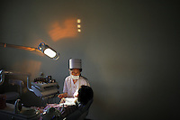 A dentist performs dental work on a patient at the Pyongyang Maternity Hospital in Pyongyang, North Korea (DPRK) on 21 August 2007