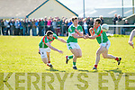 Legions James Smith chased by St Michaels Foilmore's Alan Smith and faced by D.J.Moran gets his pass away.