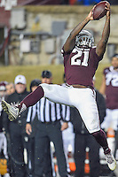 Texas A&M running back Tra Carson (21) catches a pass during an first half of an NCAA football game, Saturday, November 15, 2014 in College Station, Tex. Texas A&M leads 13-6 at the halftime. (Mo Khursheed/TFV Media via AP Images)