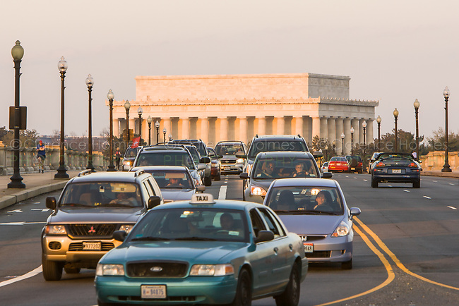 Evening traffic crosses the Arlington Memorial Bridge from DC to Arlington, Virginia, with the Lincoln Memorial in the background.