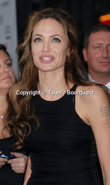 Angelina Jolie  arriving at the OCEAN 13 Premiere at the Chinese Theatre in Los Angeles.<br /> <br /> 3/4<br /> tattoo
