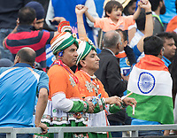 Dressed for the occasion and listening to the commentary during India vs New Zealand, ICC World Cup Semi-Final Cricket at Old Trafford on 9th July 2019