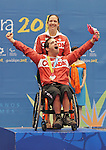 November 16 2011 - Guadalajara, Mexico:  Dave Richer and his assistant Annabelle Lefebvre after receiving his Bronze medal in Boccia BC2 in the Multipurpose Gymnasium Revolución at the 2011 Parapan American Games in Guadalajara, Mexico.  Photos: Matthew Murnaghan/Canadian Paralympic Committee