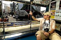 "Riding a ""baht bus"" in Thailand."