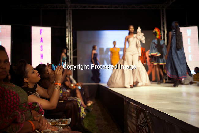 KINSHASA, DRC - JULY 24: Models walk on the catwalk during a finale at Kinshasa Fashion Week on July 24, 2015, at the boxing gym at Shark club in Kinshasa, DRC. Local and invited foreign-based designers showed their collections during the 2015 edition of Kinshasa Fashion week. (Photo by Per-Anders Pettersson)