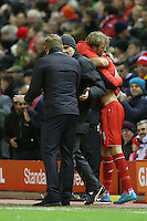 Liverpool Manager Jurgen Klopp hugs Jordan Henderson as he prepares to make his way onto the pitch during the Barclays Premier League Match between Liverpool and Swansea City played at Anfield, Liverpool on 29th November 2015